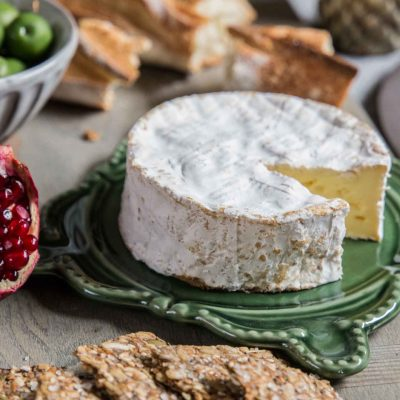 Brie cheese round & pomegranate