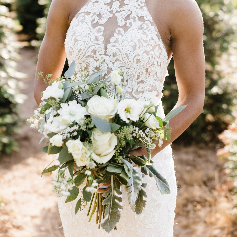 photo of a bride holding a Zupans floral bouquet