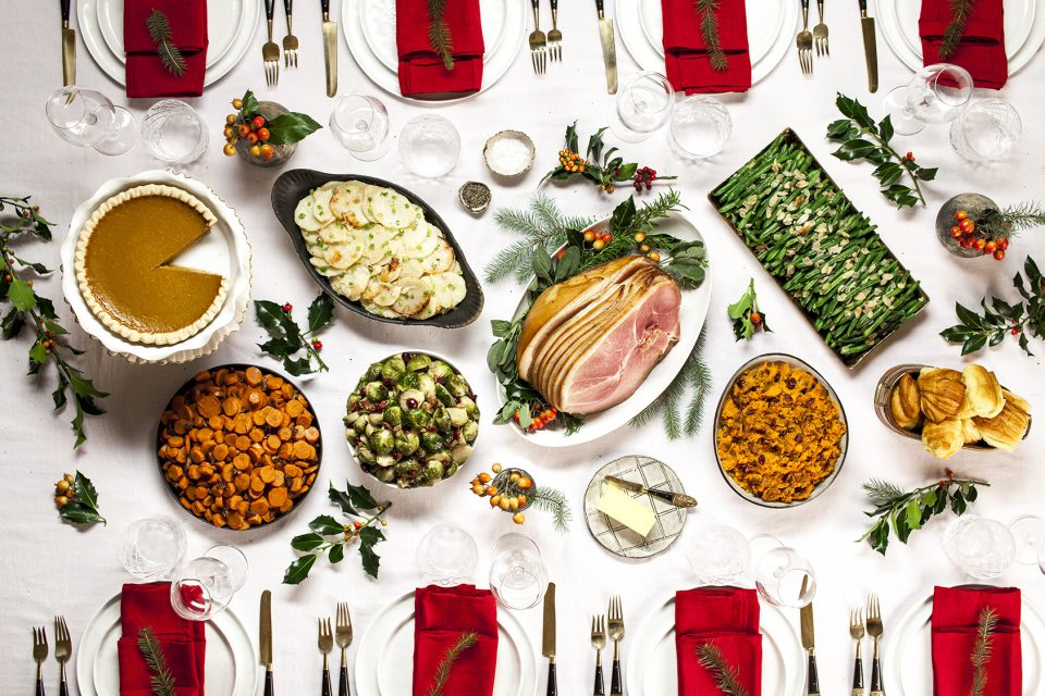 Holiday table setting featuring Christmas ham