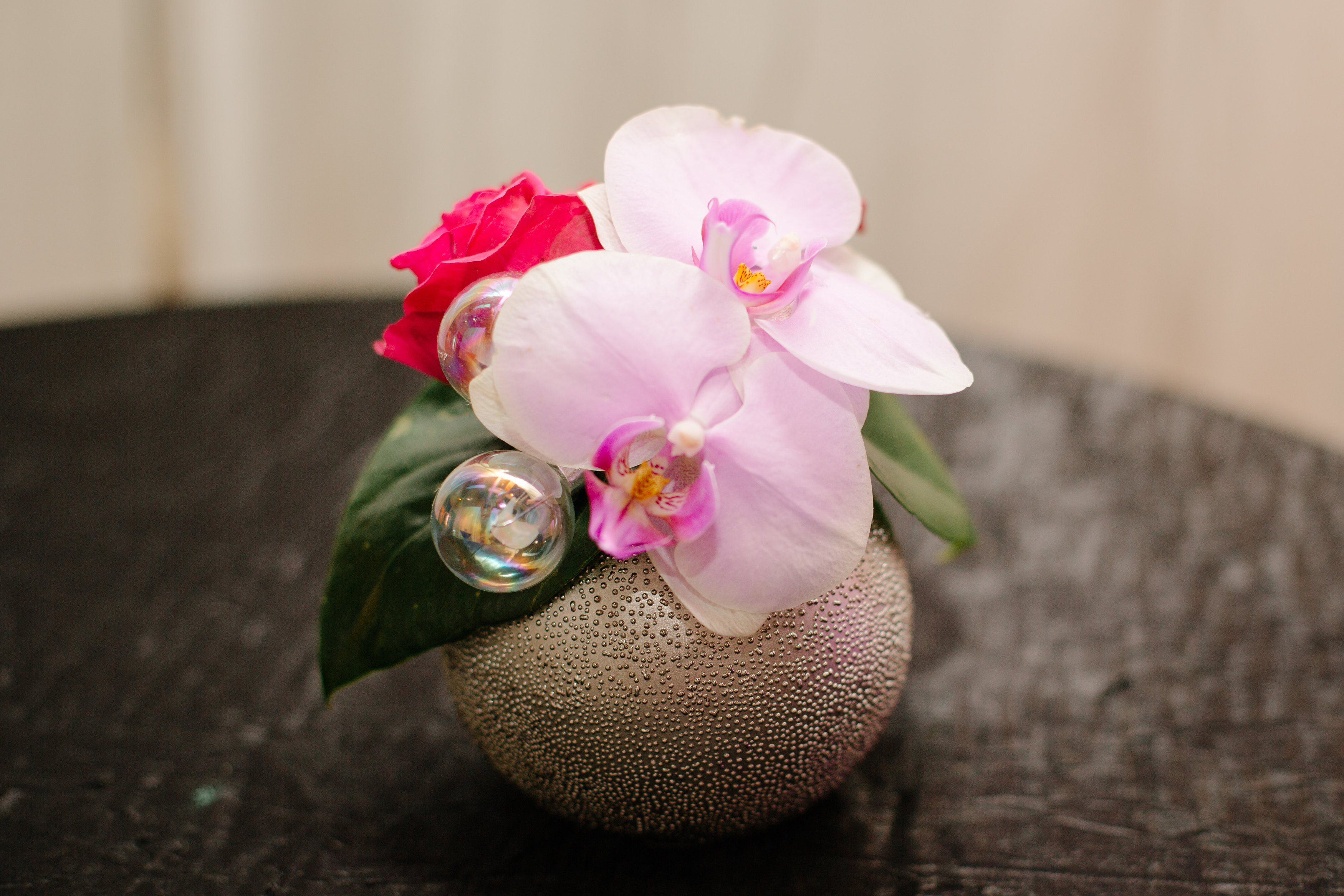A tiny pink and red flower arrangement