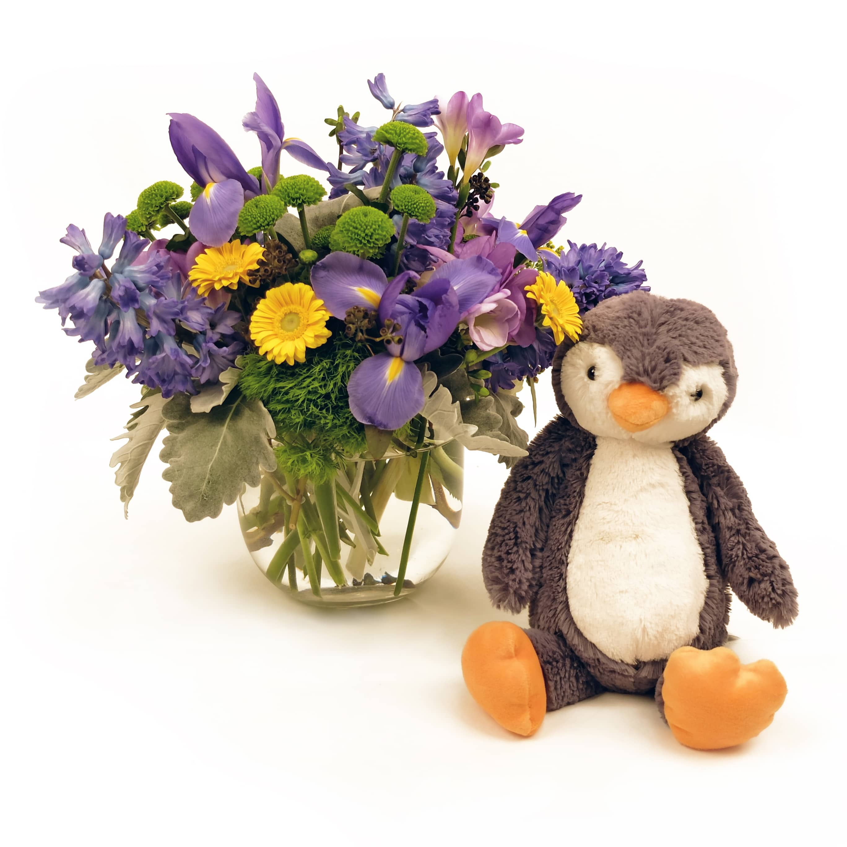 bouquet of flowers with a stuffed penguin doll