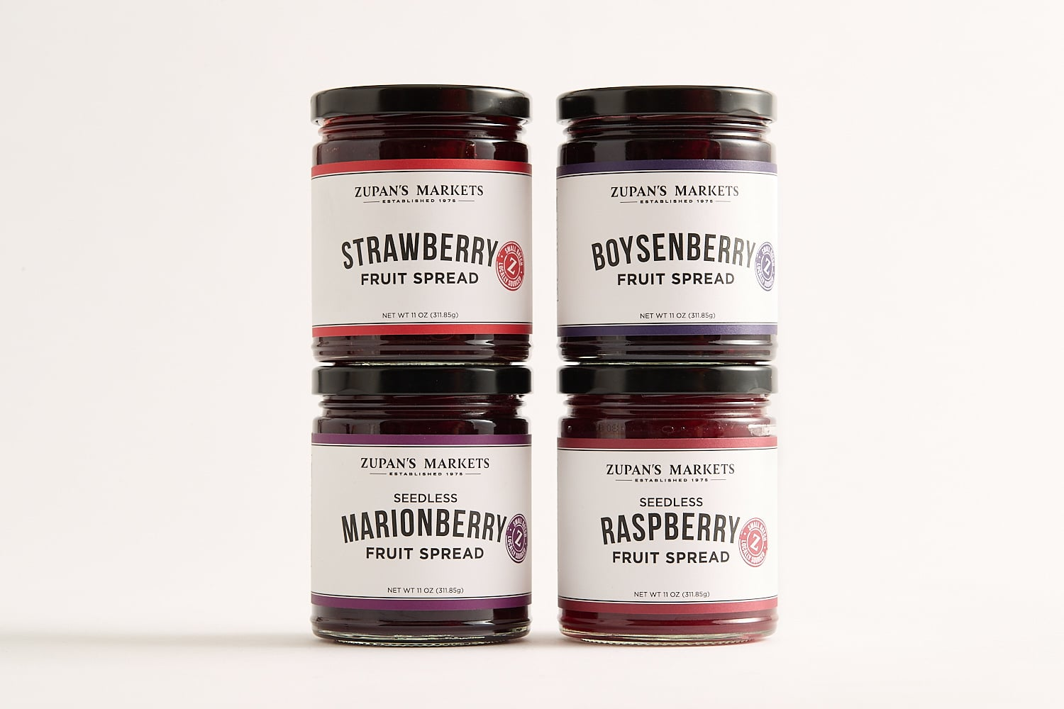 four jars of Zupan's Markets fruit spreads