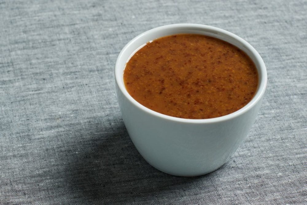 maple mustard glaze in a ramekin
