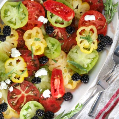 photo of an heirloom tomato salad with blackberries